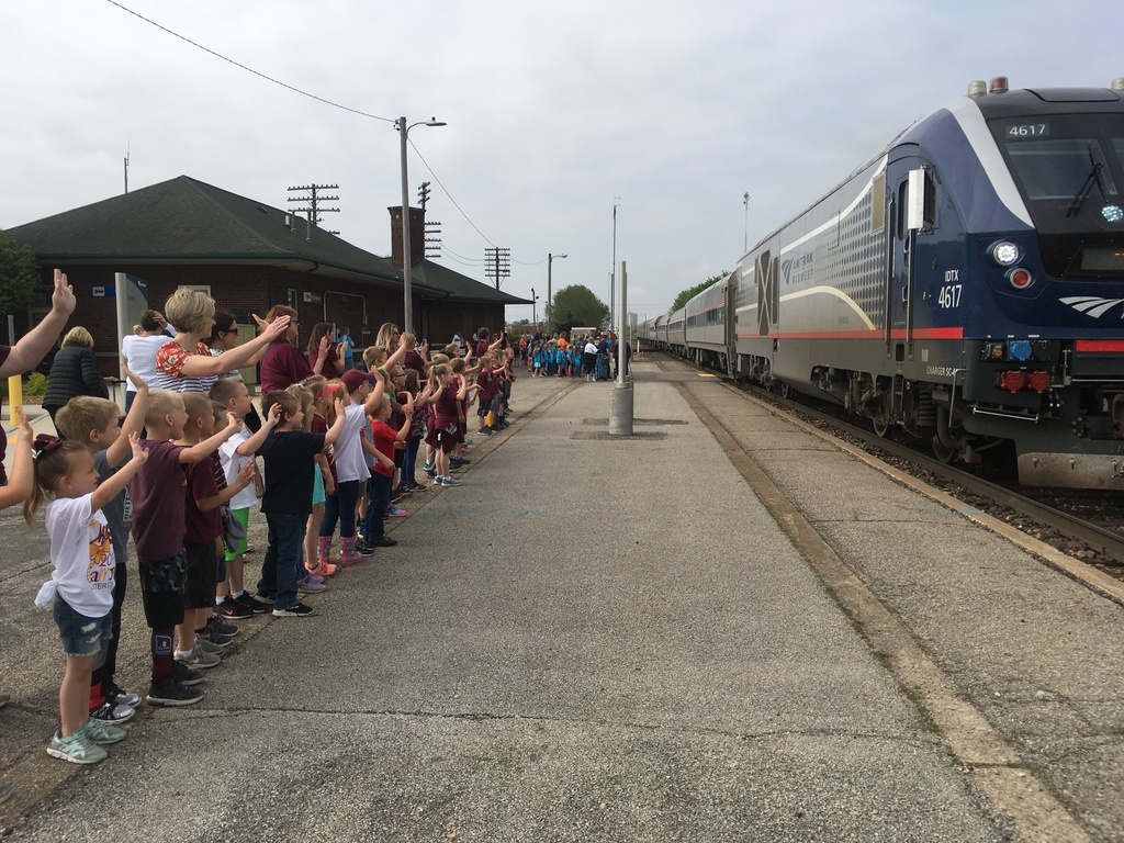 Kindergarten waiting to board the train.